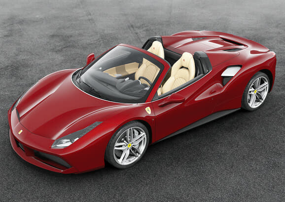 Exterior in Rosso Mugello. Thin silver line at the bottom of the windows and windshield. Chromed grilles and ball polished rims.