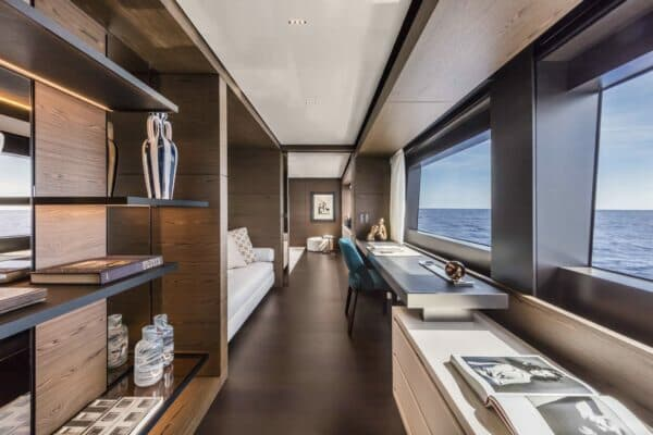 The master suite is forward on the main deck and features a stunning hallway with a private lounge and study