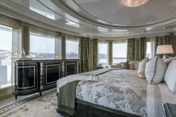 The sumptuous owner's suite offers panoramic views at anchor or under way