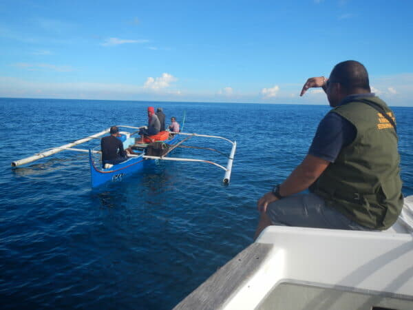 A Reef Guardian Honorary Wildlife Warden stops a boat suspected of illegal fishing activity within SIMCA