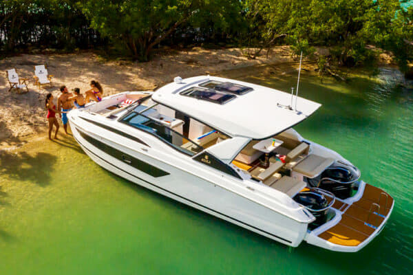 Built in China, Aquila's range of power catamarans now includes the 32, which has a swim platform that wraps around the outboards