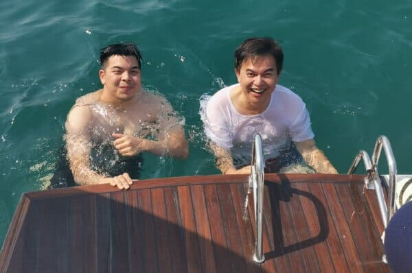 Salleh, pictured with his son Omar, enjoys sailing his Lagoon 620 to southern Thailand