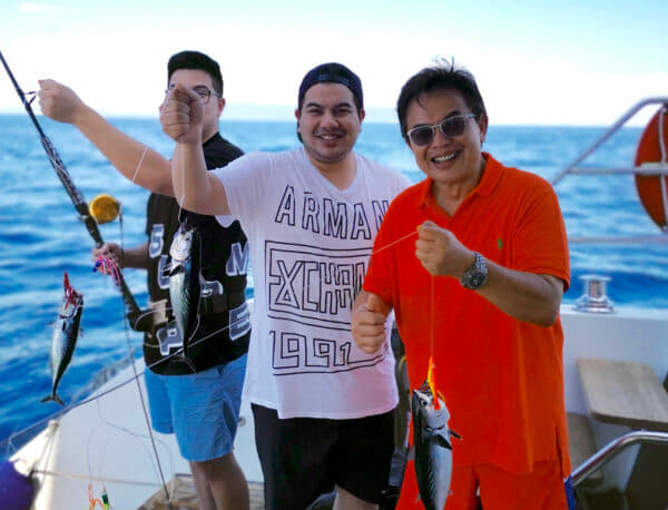 Fishing with his sons Omar and Hariz