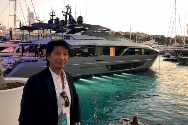 Edwin at the 2018 Monaco Yacht Show, pictured in front of a Riva 110' Dolcevita for an Asian client