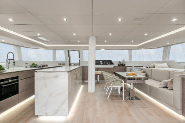 The light decor and big windows around the superstructure create a bright, inviting interior, which also includes a door to the foredeck
