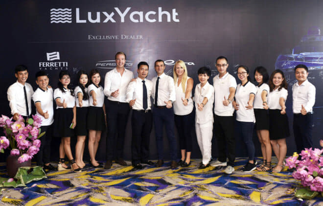 Ferretti Group Asia Pacific and LuxYacht management and staff at the signing ceremony