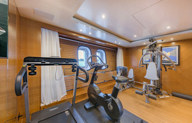 On the lower deck, the gym is midships and has a fold-down balcony