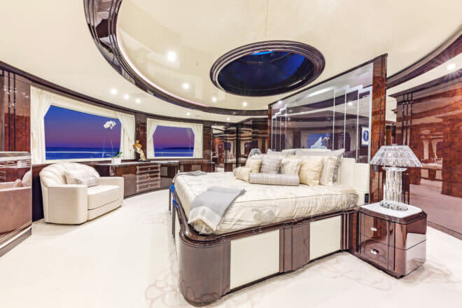 The owner's deck has a large skylounge with a bar and a piano, plus the forward owner's suite, which enjoys remarkable 180-degree views