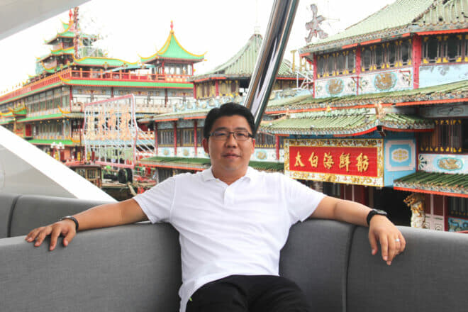 Lai on the flybridge of his Sunseeker 76 Yacht as it cruises away from the Aberdeen Boat Club, past the Jumbo Floating Restaurant