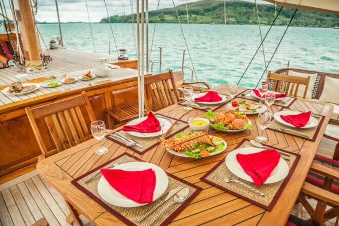 Aventure is a gorgeous 95ft wooden ketch with a teak deck a nice outdoor area for meals by the water