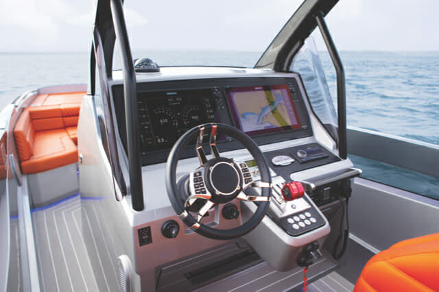 The steering wheel has multiple controls, while throttles are separate to the gear shift