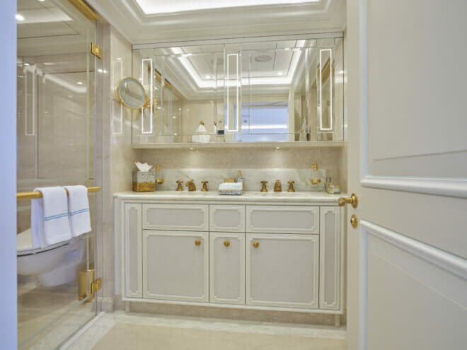 Custom vanity, linen and accessories in the bathroom continue the bamboo theme