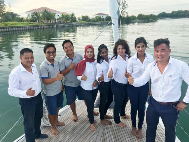 Theseira (far left), with his colleagues, is one of Malaysia's most experienced yacht dealers and a familiar face throughout boating circles in Southeast Asia