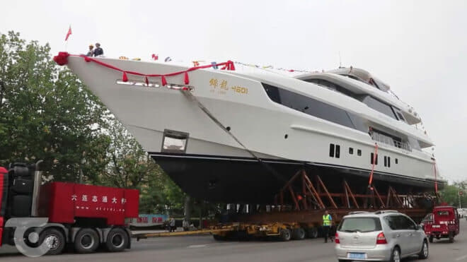 The superyacht was transported through the city centre to reach the sea