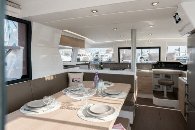 The saloon and master cabin on the Bali 4.1 sailing catamaran, which is 12.1m long with a beam of 6.7m and features interior decor by Lasta Design Studio