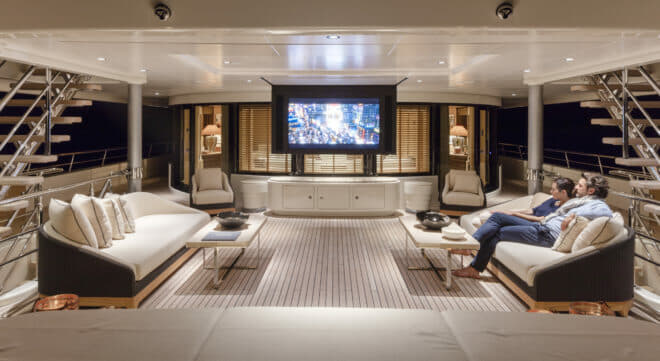 Bridge deck aft features an attractive al fresco lounge with large sofas, coffee tables and a retractable screen, ideal for a movie night to round off the day