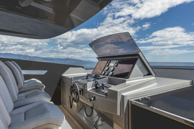Pershing 140: The flybridge has six pilot seats at the helm, where the screens and windshield can fold down