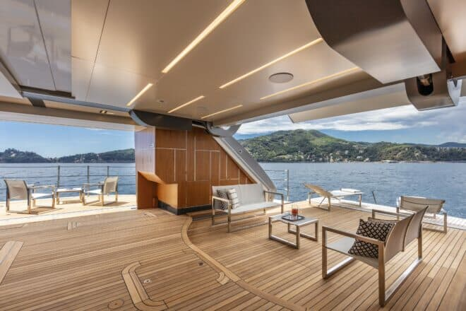 Pershing 140: Once the tender and toys are moved out, the high-ceilinged garage becomes the interior hub of the spectacular three-sided beach club