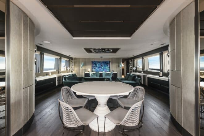 Pershing 140: Kuala Lumpur-based Edith Ho designed Chorusline's interior, selecting a Julien Calot painting and water droplets by Milan Design Studio for the saloon