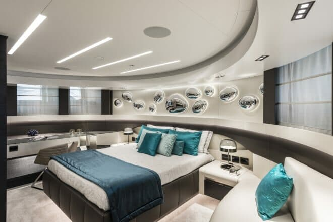 Pershing 140: The curvy master suite in the bow feels almost space age with its futuristic lighting and the yacht's signature water droplets