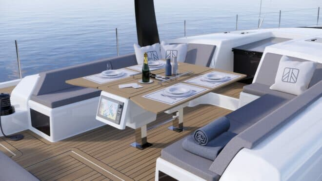 An adjustable table provides comfortable al fresco dining on the Dufour 61