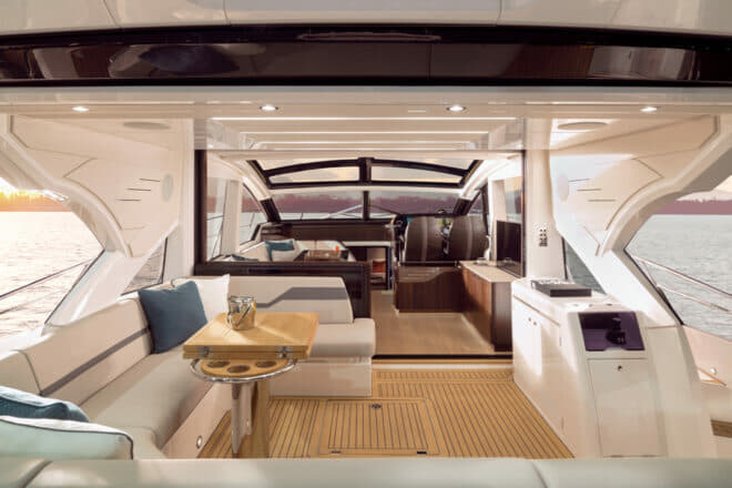 When the cockpit window is lowered and the starboard door is opened, the cockpit and saloon combine to form a large and attractive living area