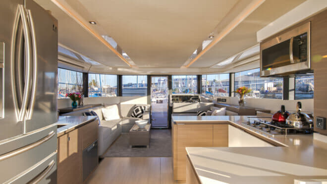 The enormous fridge is on your left as you enter the interior; the foredeck door is straight ahead, connecting the length of the yacht