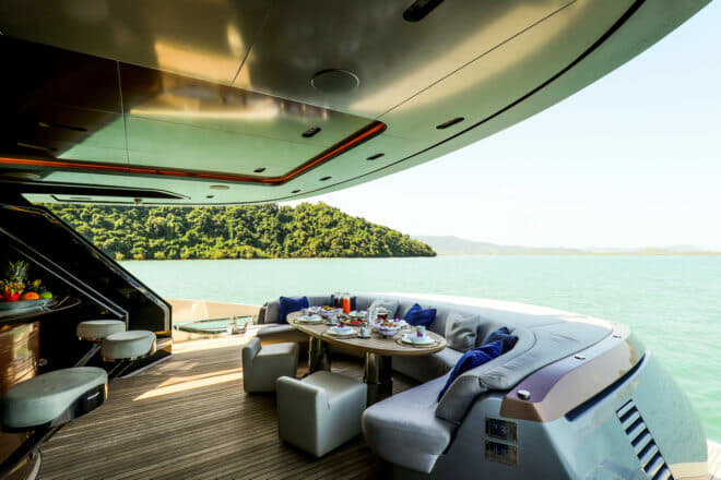 A bar (left) extends the entertainment in the covered aft deck