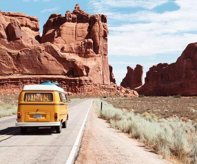 car on the road, rocks