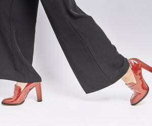 wide-leg pants with red heels